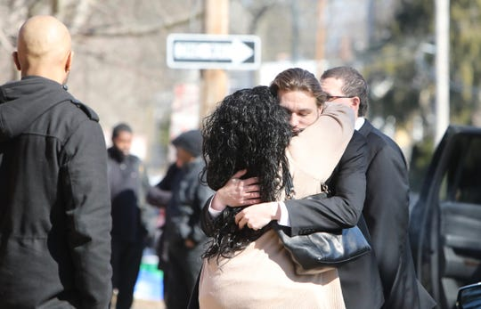 Ryan Christopher, brother of Melissa DeLoatch, is consoled before DeLoatch's funeral at St. Ann's Church in Nyack Feb. 28, 2019.