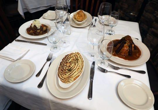 Clockwise from front: Shepherd's Pie, Irish Beef Stew, Chicken Pot Pie and Irish Bangers & Mash at Hurley's Steakhouse in New Rochelle, Feb. 28, 2019.