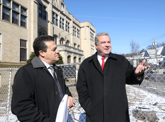 Yonkers Schools Superintendent Edwin Quezada and Yonkers Mayor Mike Spano are pictured in front of the closed St. Denis School on McLean Avenue in Yonkers, Feb. 28, 2019.