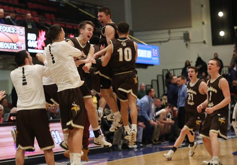 Clarkstown South players celebrate their thrilling come from behind victory over Suffern to win the boys Class AA basketball semifinal at the Westchester County Center in White Plains  Feb. 27,  2019.