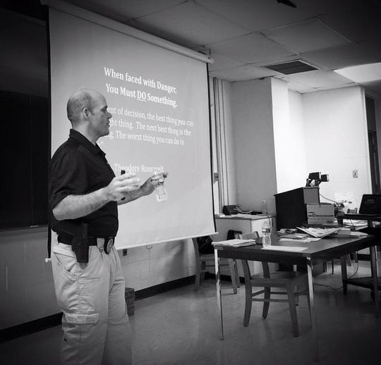 """Detective Joseph Melvin of the Georgetown Police Department conducts a training session on preparing for an active shooter situation."""""""