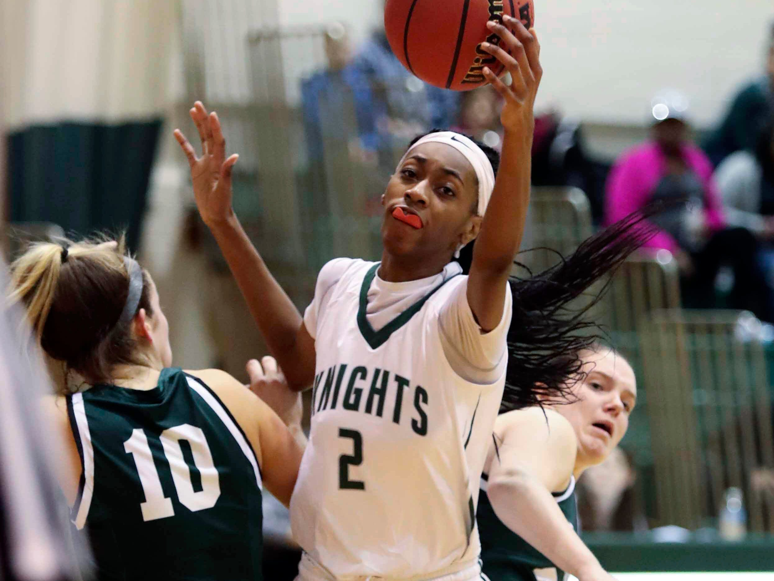Mount Pleasant's Zaria Newson grabs the ball between Archmere's Isabella Gioffre (left) and Catherine McGonigle as the Auks advance, 35-27, in the opening round of the DIAA state tournament Wednesday at Mount Pleasant.