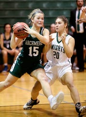 Archmere's Sydney Niumataiwalu (left) looks to pass past Mount Pleasant's Kylee Balbach as the Auks advance, 35-27, in the opening round of the DIAA state tournament Wednesday at Mount Pleasant.