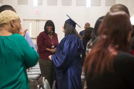 Graduates from the 80th Delaware Mentor Program Inc. Pre-Release Class exit the chapel to applause Tuesday night at Baylor Correctional Institution.