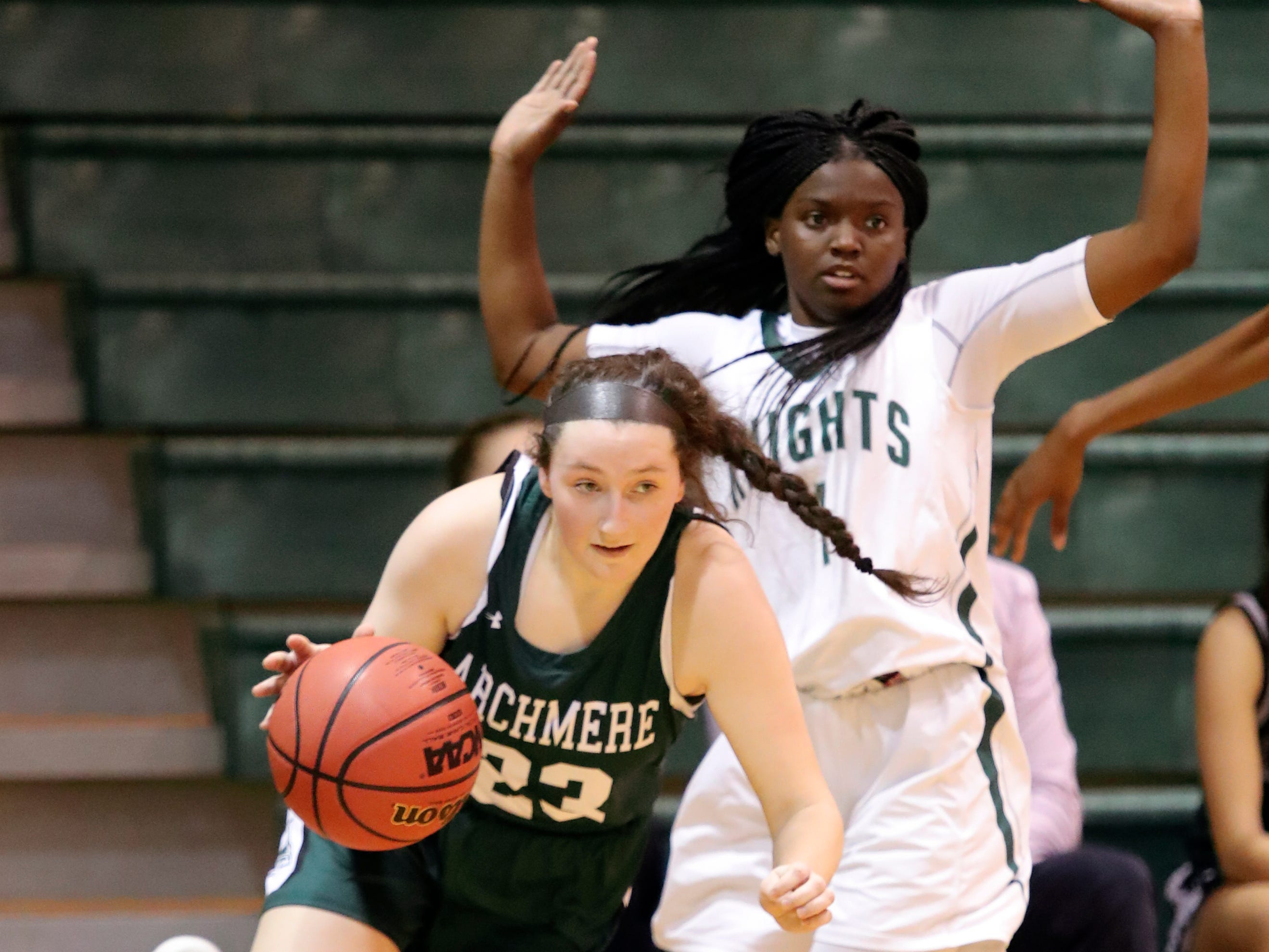 Archmere's Emma McCann (left) pushes past Mount Pleasant's Na'Caia Jackson as the Auks advance, 35-27, in the opening round of the DIAA state tournament Wednesday at Mount Pleasant.
