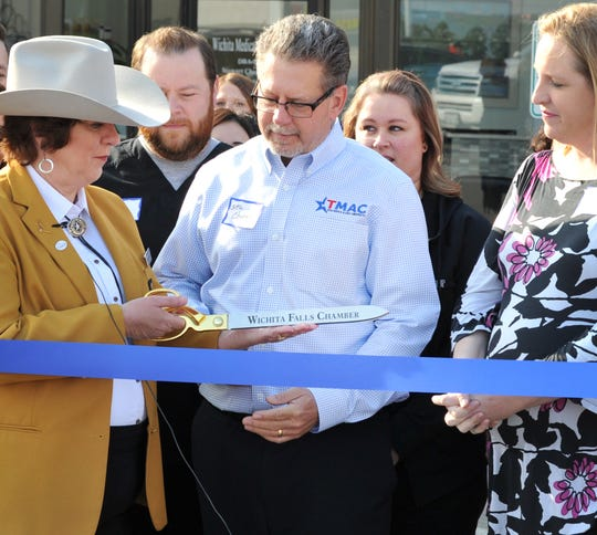 Texas Medical Allergy Chiropractic (TMAC), co-owner, Dr. Stewart Chapman prepares to cut a ribbon in celebration of the opening of his business located in the 3800 block of Call Field Rd., Thursday morning.