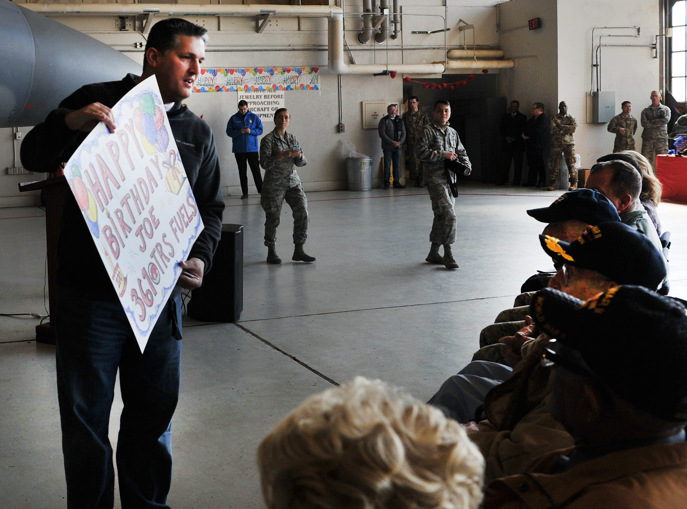 361st Aircraft Fuel Systems, instructor, John Stutts presented a large birthday card signed by the staff to Joe Cuba's birthday celebration held at Sheppard Air Force Base, Thursday afternoon.