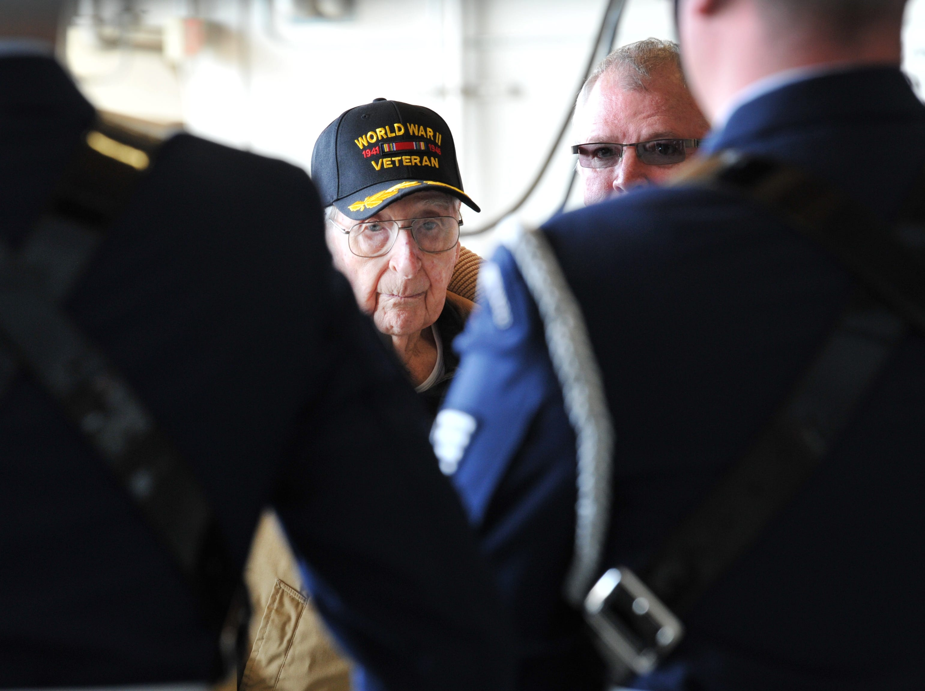 Army Air Corps Staff Sgt. Joe Cuba, centered watched as the Sheppard Air Force Base Color Guard present the colors during a celebration held to honor Mr. Cuba for his 100th birthday.