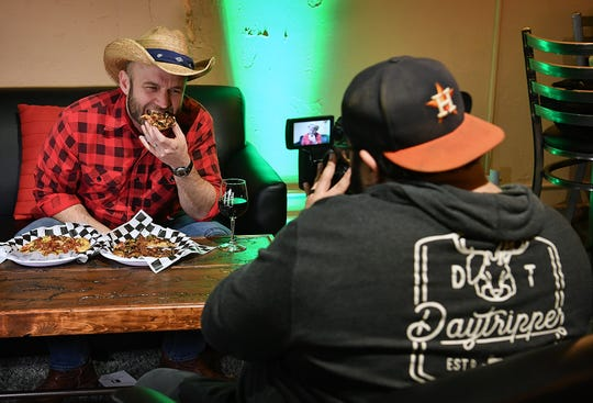 Chet Garner, host of the PBS television show The Daytripper, enjoys a selection of flatbreads at Hook & Ladder Wine & Coffee while filming in Wichita Falls Wednesday.
