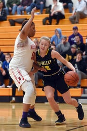 Audrey Spiker drives the baseline on Westerville South's Aja Austin during Tri-Valley's 56-54 loss in a Division I district semifinal on Wednesday night at Heath High School.