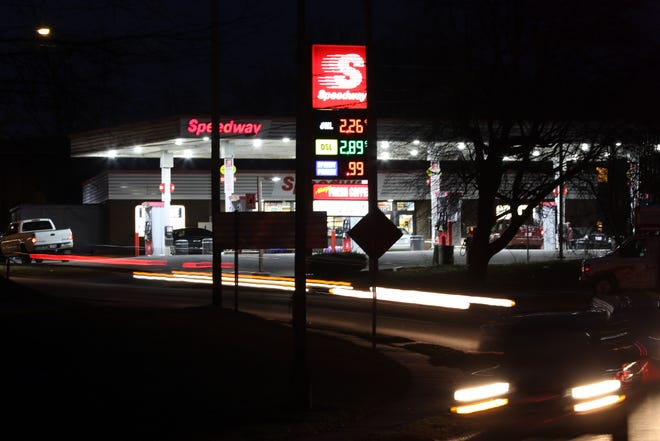 Evening traffic streams past the Speedway station on Blue Avenue in Zanesville.