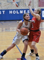 Maysville's Bailee Smith goes up for a shot against Minerva's Elyssa Imler during Wednesday's 58-46 district semifinal win.