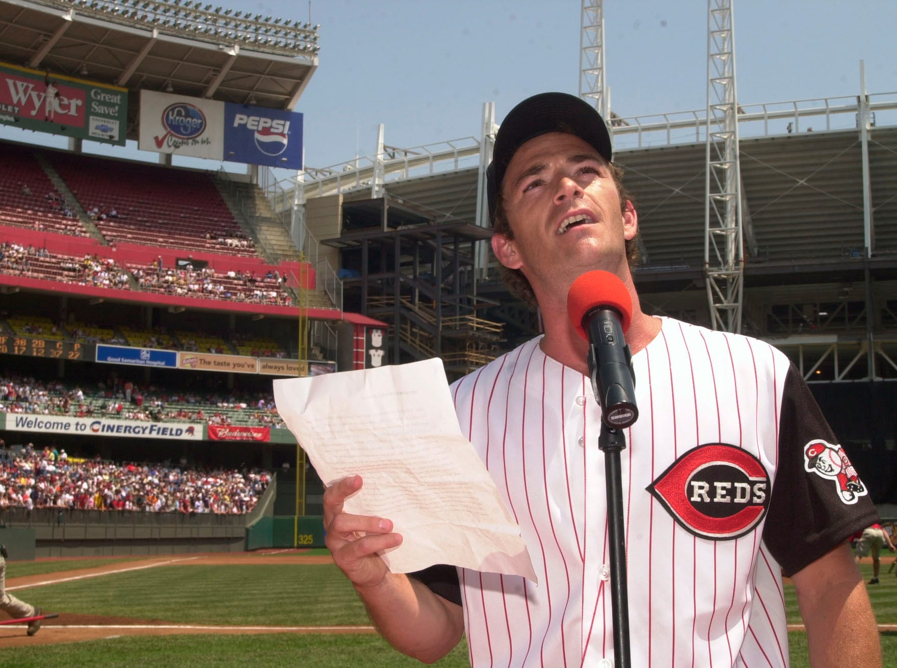 Actor Luke Perry reads Lou Gehrig's historical farewell speech Saturday, June 1, 2002 prior to the Atlanta Braves/Cincinnati Reds' game at Cinergy Field in Cincinnati. Celebrities in 14 ballparks across the country recited the speech as part of Project A.L.S. Day.