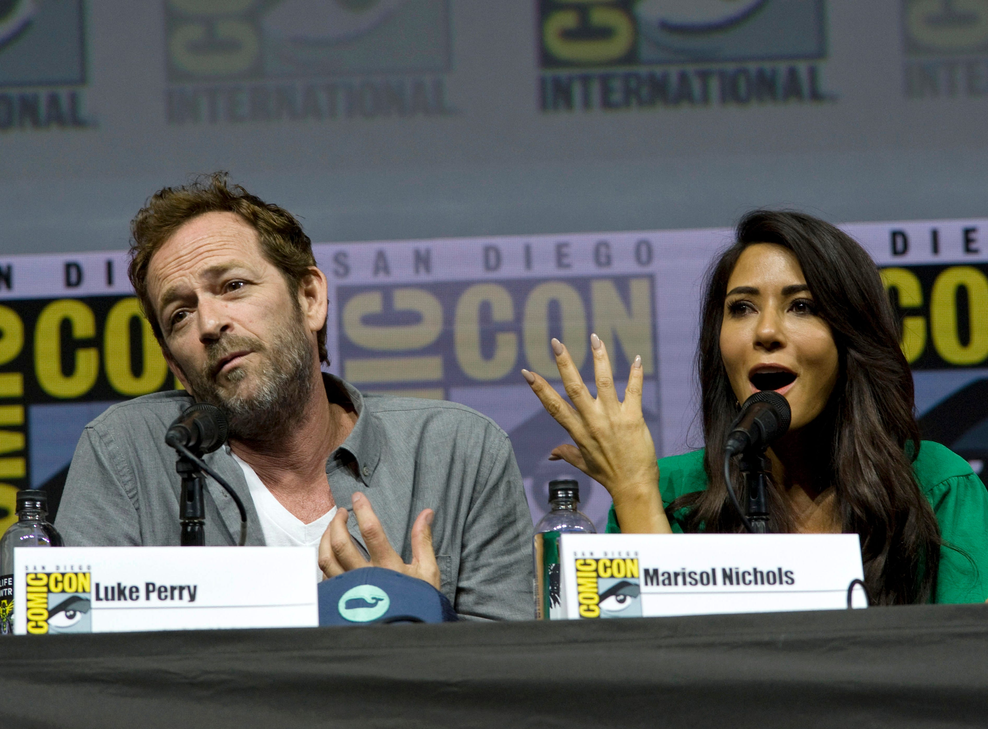 Cast from the television series, Riverdale, Luke Perry and Marisol Nichols, speak during a panel presentation at Comic Con International in San Diego, Calif. on July 22, 2018.