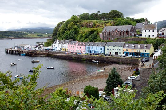 Portree, the largest town on the Isle of Skye, is nestled deep in its protective harbor.