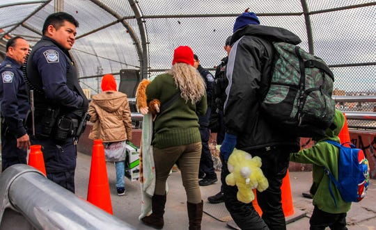 Office of Customs and Border Protection agents allow access to the United States to a group of 33 migrants seeking political asylum in the U.S.