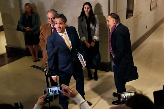Michael Cohen, President Donald Trump's former lawyer, speaks briefly to the media as he leaves a closed-door hearing of the House Intelligence Committee accompanied by his lawyer, Michael Monico, of Chicago, Thursday, Feb. 28, 2019, on Capitol Hill in Washington.