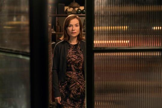 When Frances stops speaking to her, Greta (Isabelle Huppert) stalks her at the restaurant where she works.