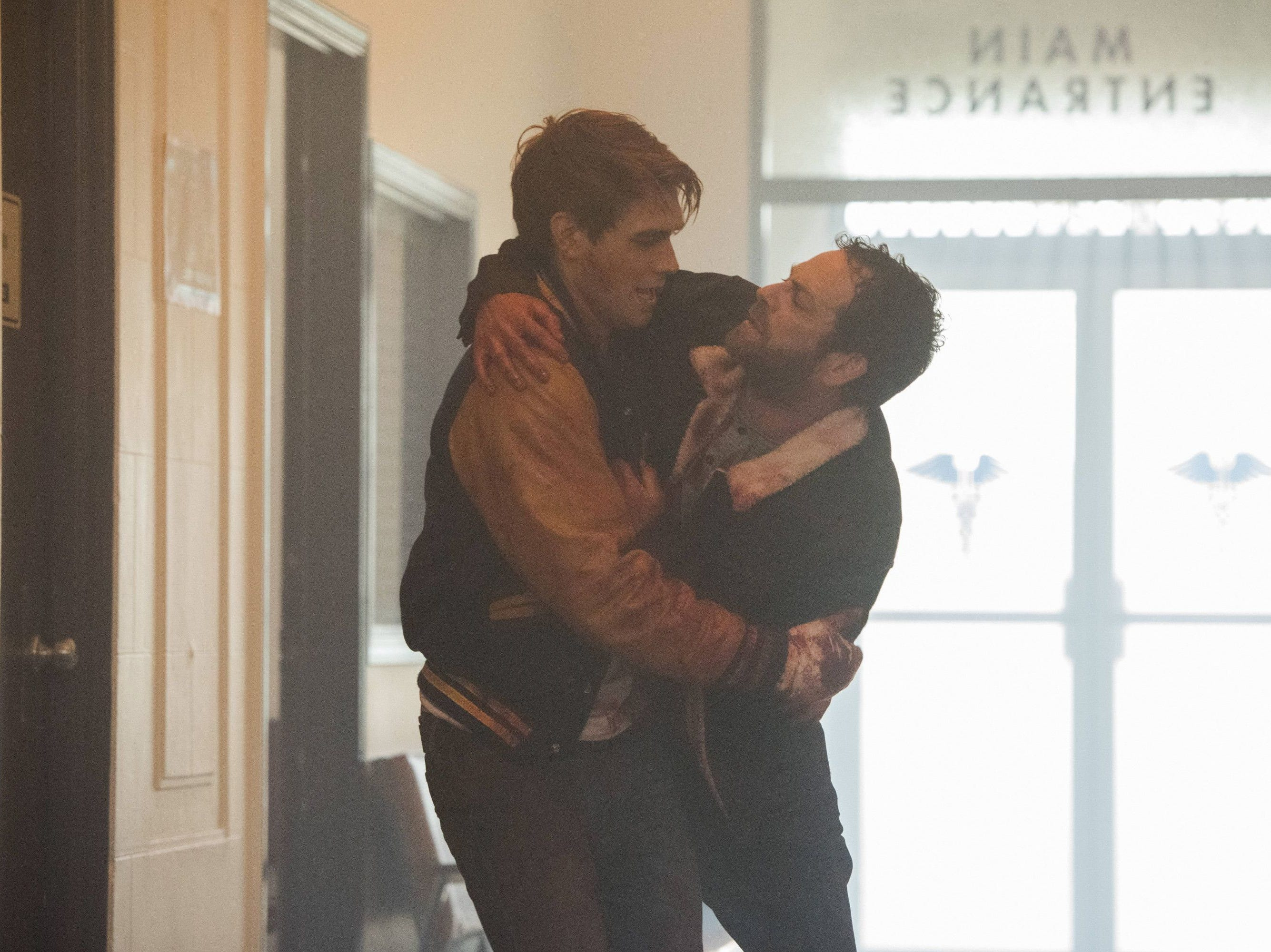 Archie (K.J. Apa, left) fights to save his dad (Luke Perry) after he's shot in 'Riverdale.'
