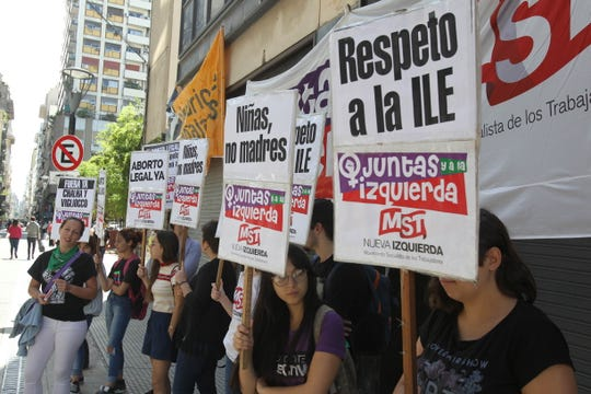 People protest in Buenos Aires, Argentina, on Feb. 25, 2019, to demand the court allow an abortion for an 11-year-old who was raped by her grandmother's partner.