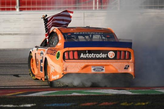 Brad Keselowski celebrates with a burnout after winning at at Atlanta Motor Speedway last weekend.