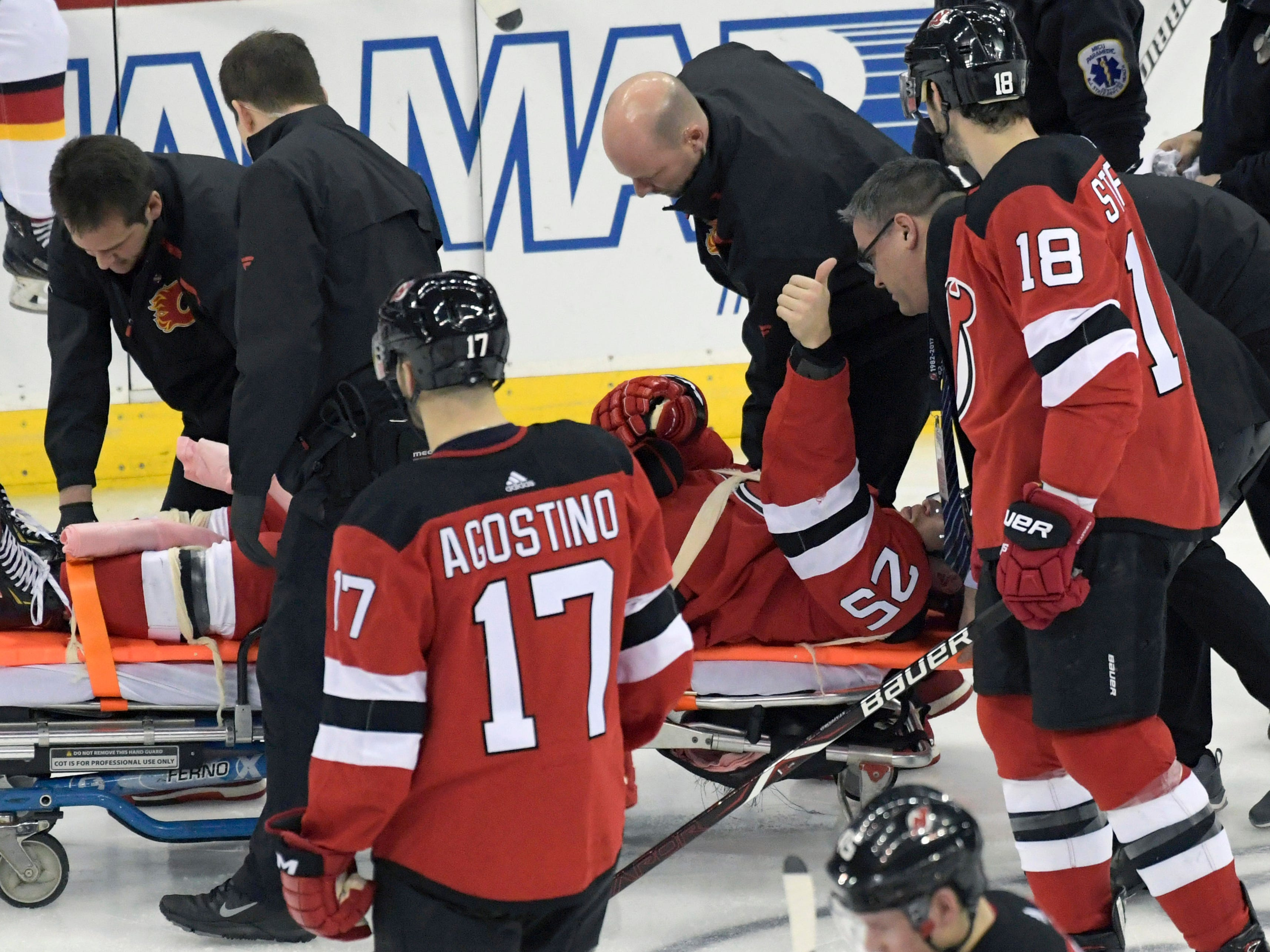 Feb. 27: New Jersey Devils defenseman Mirco Mueller gives a thumbs up as he is wheeled off the ice on a stretcher after crashing into the boards. The team said he had full feeling and movement in his extremities, was alert and taken to the hospital for tests.