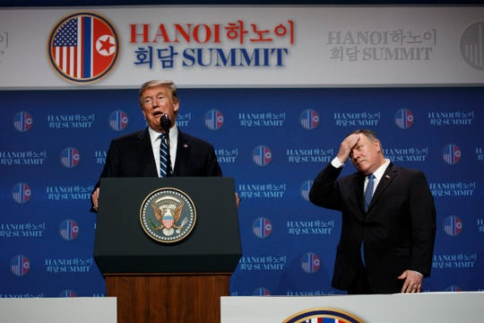 President Donald Trump speaks as Secretary of State Mike Pompeo looks on during a news conference after a summit with North Korean leader Kim Jong Un, Feb. 28, 2019, in Hanoi.  President Trump abruptly ended a long-planned summit with North Korea's Kim Jong Un on Thursday, acknowledging the two leaders did not reach an agreement that accomplished the U.S. goal of denuclearizing the Korean Peninsula.