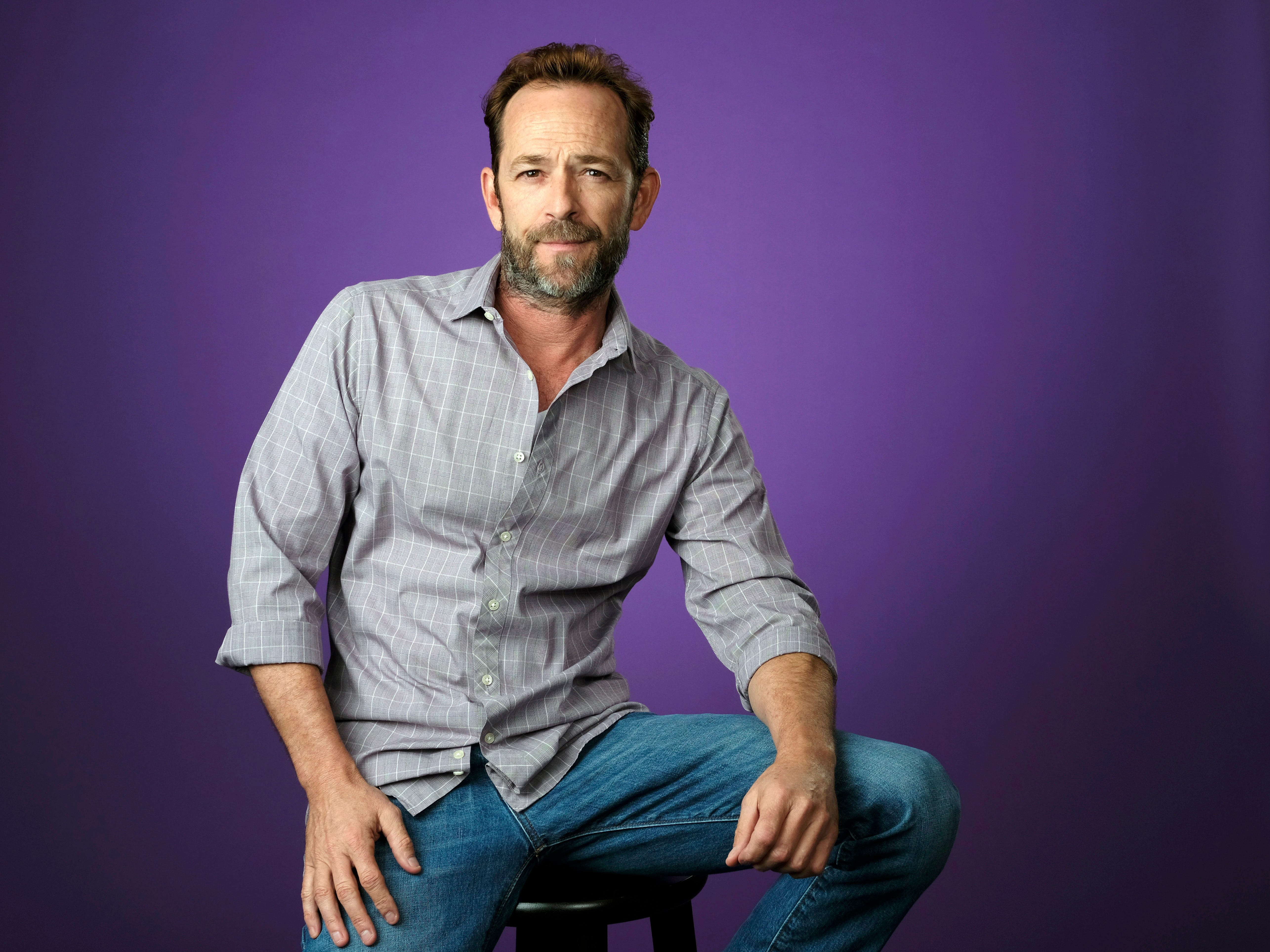 "In this Aug. 6, 2018, file photo, Luke Perry, a cast member in the CW series ""Riverdale,"" poses for a portrait during the 2018 Television Critics Association Summer Press Tour in Beverly Hills, Calif. A publicist for the ""Riverdale"" and ""Beverly Hills, 90210"" star says the actor has been hospitalized. Arnold Robinson said the 52-year-old actor is ""currently under observation"" at the hospital."