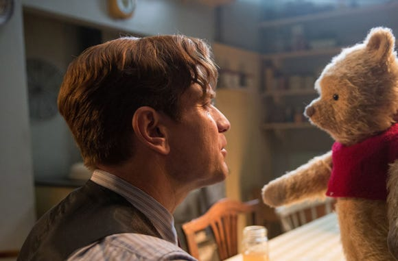 "Christopher Robin (Ewan McGregor) and his longtime friend Winnie the Pooh in Disney's ""Christopher Robin."""