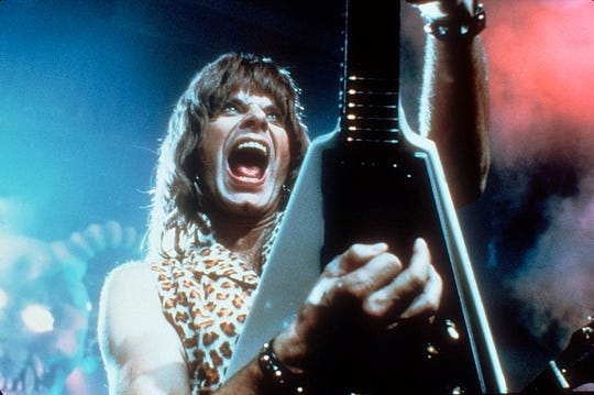 "Christopher Guest rocks out as Nigel Tufnel in ""Spinal Tap"""