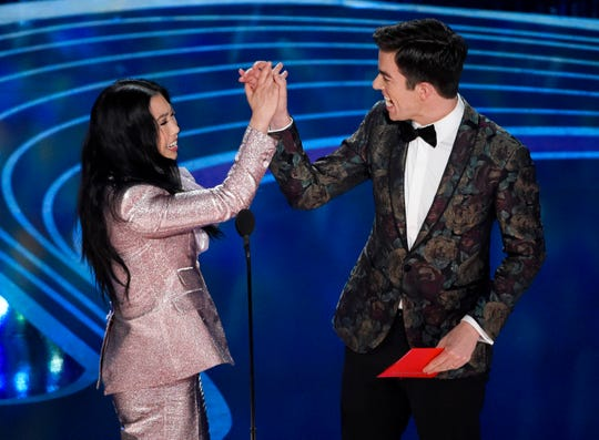 Awkwafina, left, and John Mulaney present the award for best animated short at the Oscars on Sunday, Feb. 24, 2019, at the Dolby Theatre in Los Angeles. (Photo by Chris Pizzello/Invision/AP) ORG XMIT: CADA613