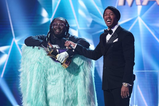 """THE MASKED SINGER: L-R: T-Pain and host Nick Cannon in the special two-hour """"Road to the Finals / Season Finale: The Final Mask is Lifted"""" season finale episode of THE MASKED SINGER airing Wednesday, Feb. 27 (8:00-10:00 PM ET/PT) on FOX. © 2019 FOX Broadcasting. CR: Michael Becker / FOX."""