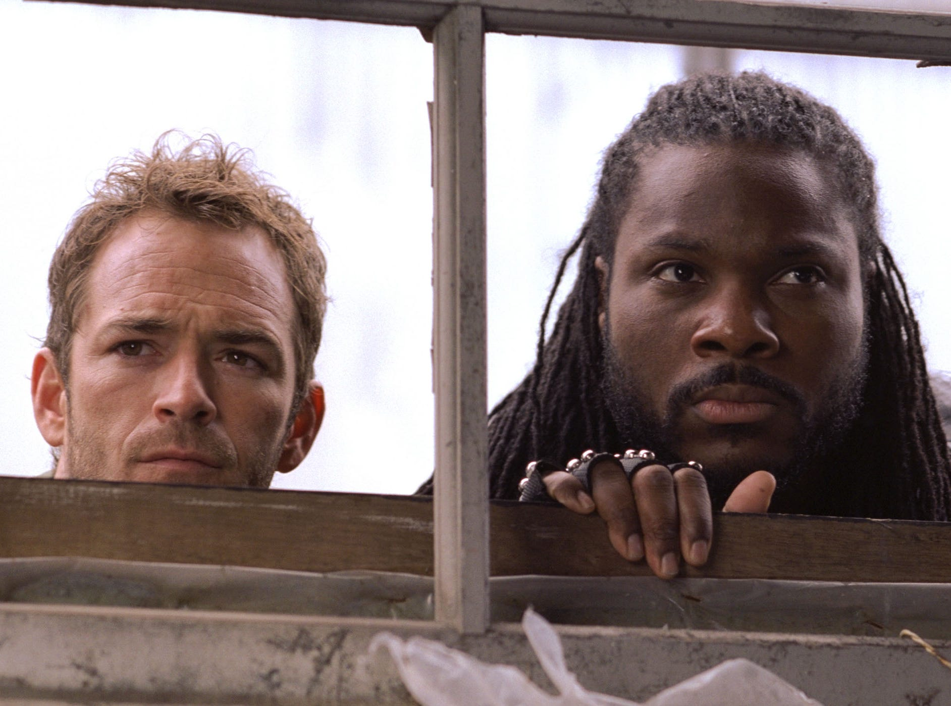Luke Perry as Jeremiah and Malcolm-Jamal Warner as Kurdy on the Showtime program Jeremiah.