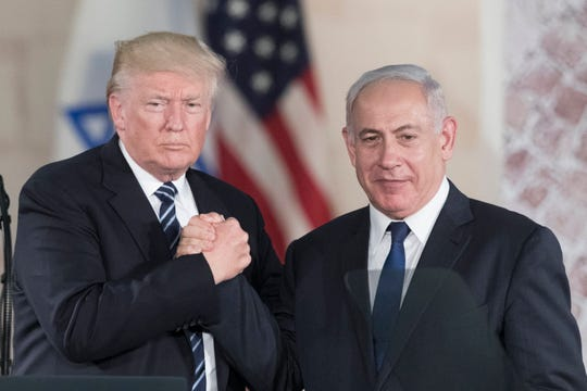 epa05983903 US President Donald J. Trump (L) and Israeli Prime minister Benjamin Netanyahu (R) hold hands  after Trump delivers  a speech at the Israeli Museum, Jerusalem, 23 May 2017. President Trump and his contingent are in Israel for a 28-hour visit to Israel and the Palestinian Authority areas on his first foreign trip since taking office in January.  EPA/ABIR SULTAN