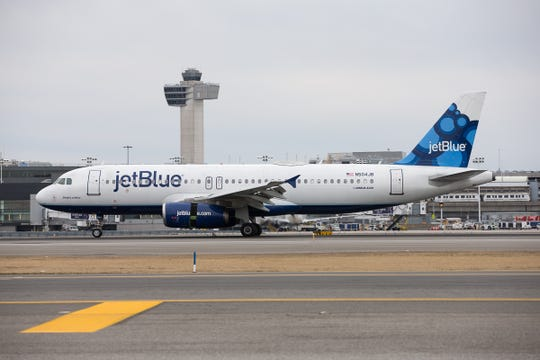 A JetBlue Airbus A320 lands at New York JFK on Feb. 17, 2019.