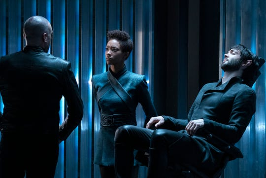 Michael Burnham (Sonequa Martin-Green), center, looks out for her incapacitated adoptive brother, Spock (Ethan Peck), right, in Thursday's episode of CBS All Access's 'Star Trek: Discovery.'