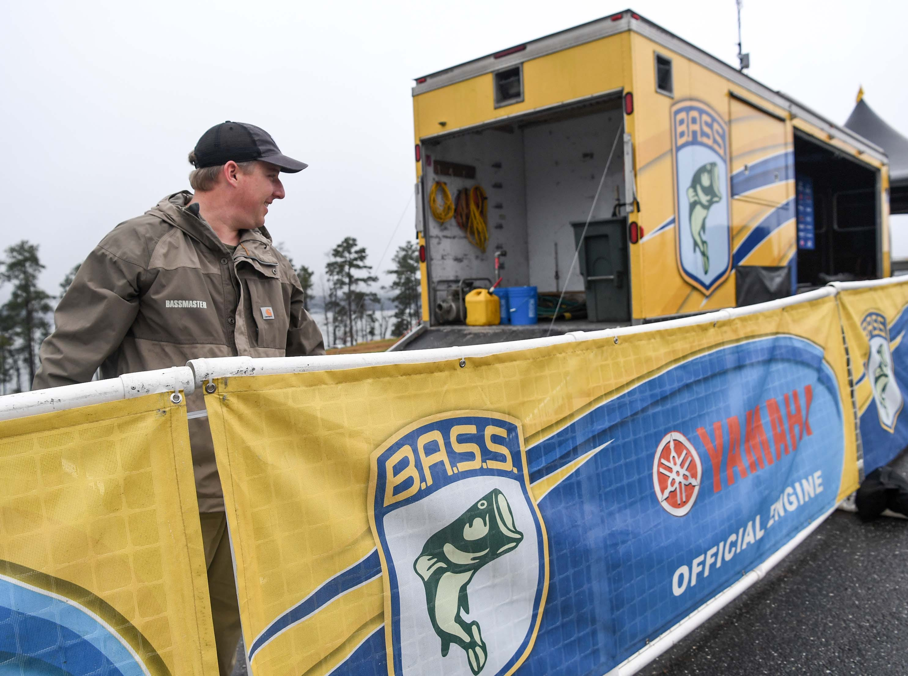 Hank Weldon, director of the high school and college Bassmaster organization, helps set up for the Mossy Oak Fishing Bassmaster High School Open at the Green Pond Boat Landing on Hartwell Lake in Anderson Friday. The event begins 6:45 a.m. at the landing, with 87 schools from 15 states participating he said.