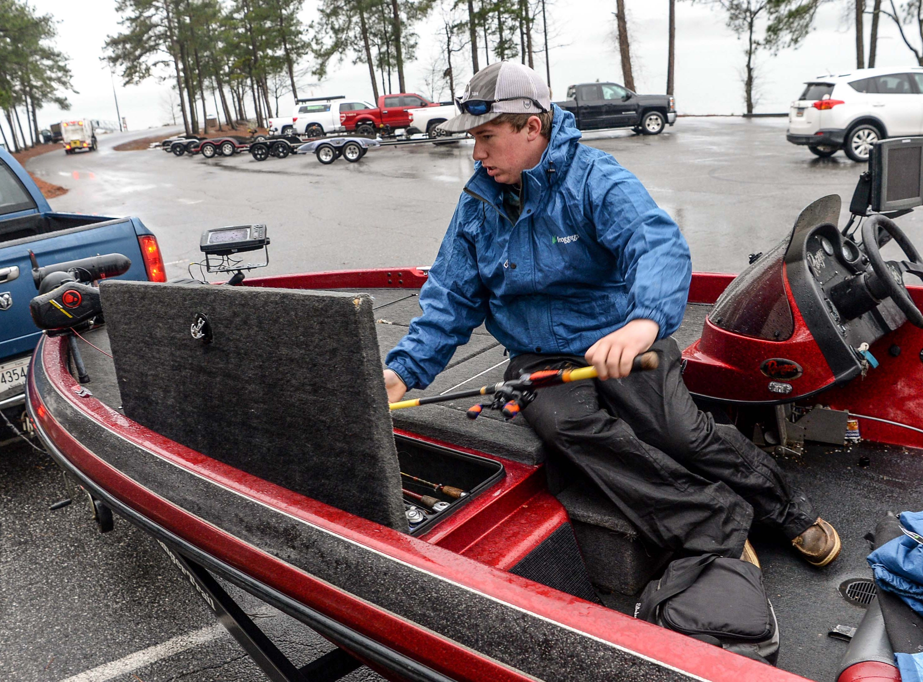 Vernon Reynolds, 15, of North Augusta High School Fishing Team checks his poles before a practice before the Mossy Oak Fishing Bassmaster High School Open at the Green Pond Boat Landing on Hartwell Lake in Anderson Friday. The official event, with 87 schools from 15 states, starts at the boat landing at 6:45 a.m. Saturday morning.