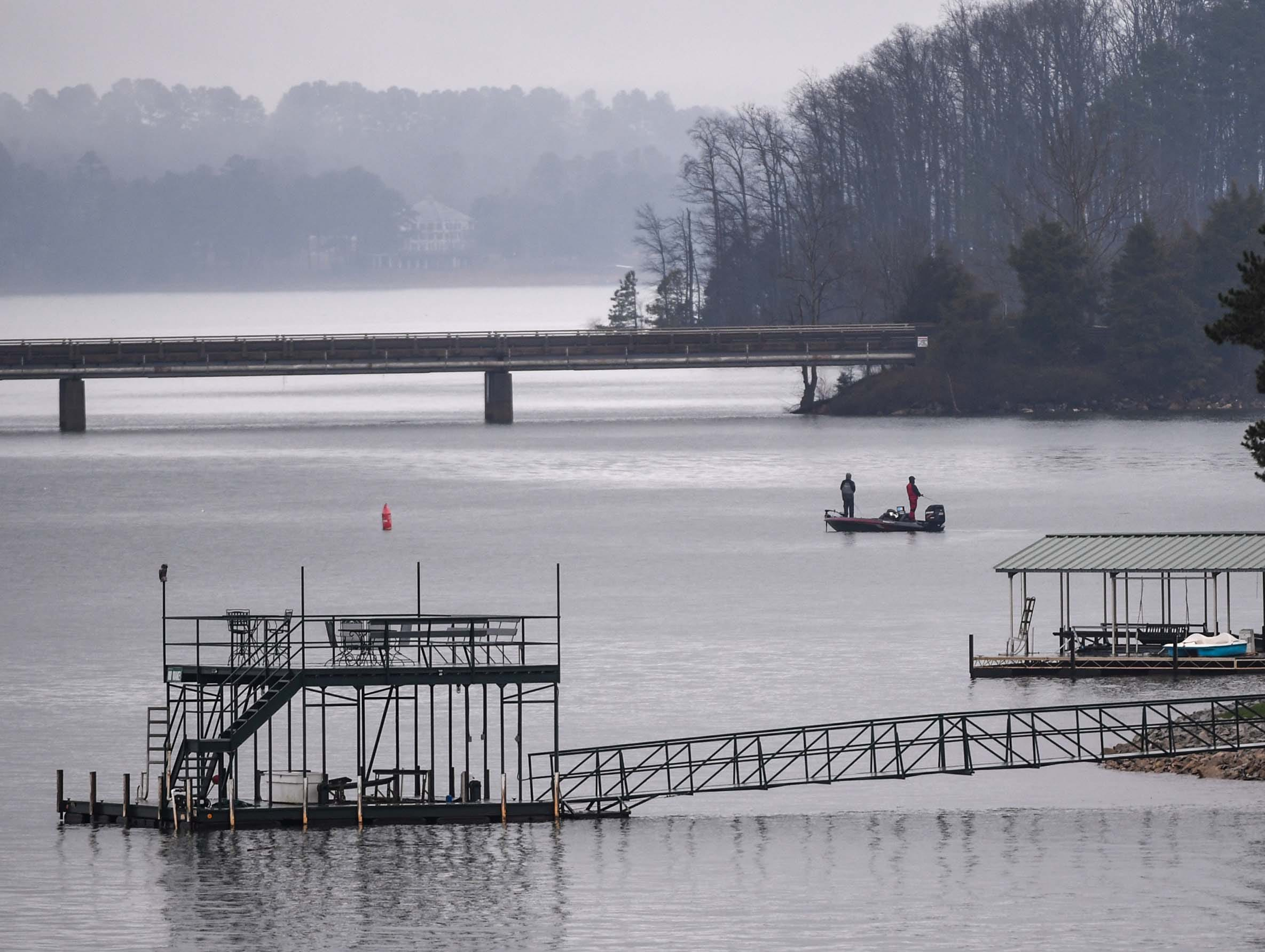 A boat with high school students practices fishing before the Mossy Oak Fishing Bassmaster High School Open at the Green Pond Boat Landing on Hartwell Lake in Anderson Friday. The official event, with 87 schools from 15 states, starts at the boat landing at 6:45 a.m. Saturday morning.