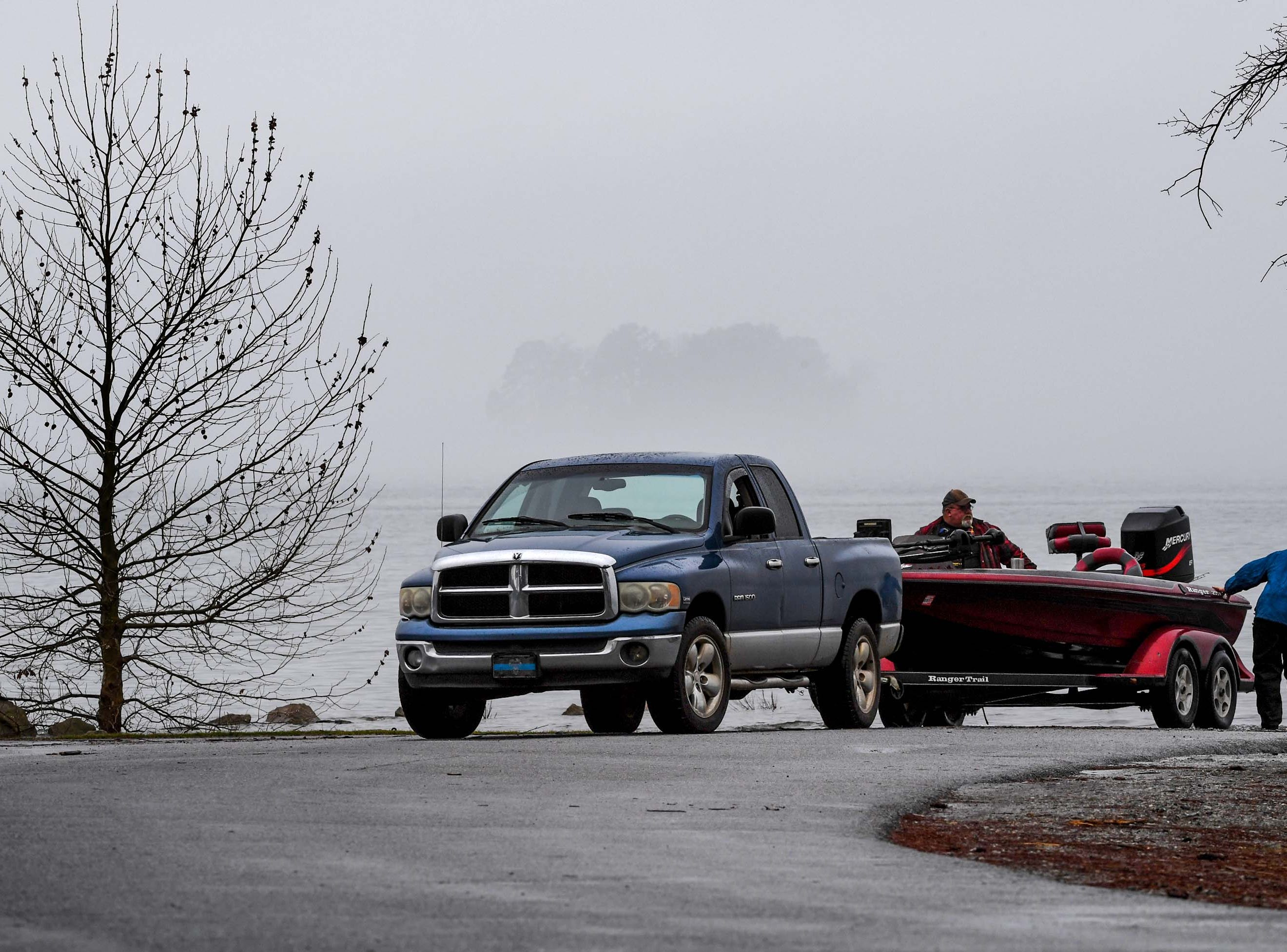 Vernon Reynolds, 15, right, of North Augusta High School Fishing Team checks the boat he would ride at practice for the Mossy Oak Fishing Bassmaster High School Open at the Green Pond Boat Landing on Hartwell Lake in Anderson Friday. The official event, with 87 schools from 15 states, starts at the boat landing at 6:45 a.m. Saturday morning.