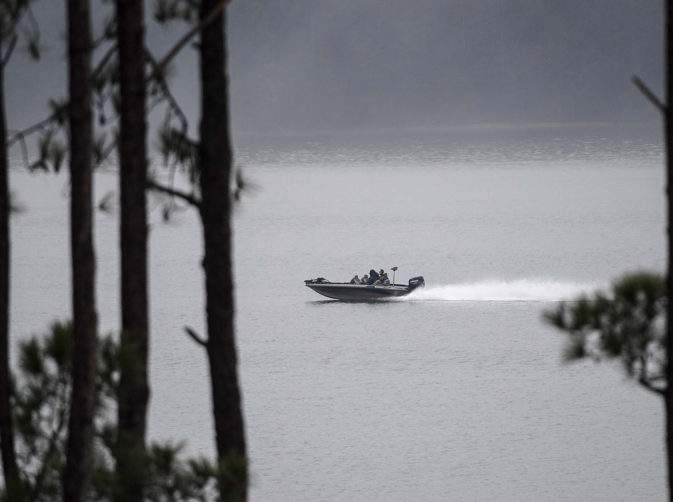 A boat with high school students moves around for practice before the Mossy Oak Fishing Bassmaster High School Open at the Green Pond Boat Landing on Hartwell Lake in Anderson Friday. The official event, with 87 schools from 15 states, starts at the boat landing at 6:45 a.m. Saturday morning.