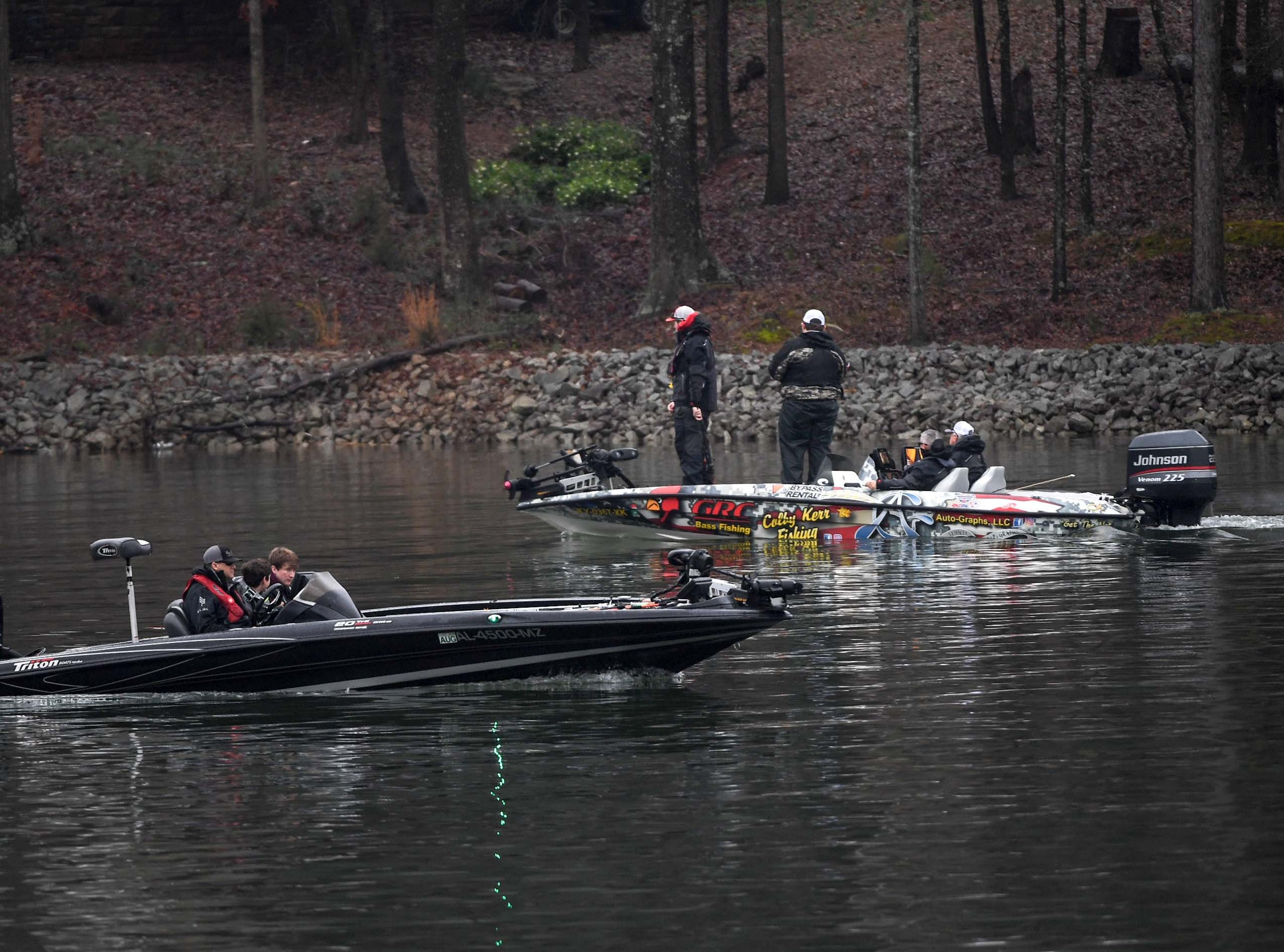 Two boats with high school students practice before the Mossy Oak Fishing Bassmaster High School Open at the Green Pond Boat Landing on Hartwell Lake in Anderson Friday. The official event, with 87 schools from 15 states, starts at the boat landing at 6:45 a.m. Saturday morning.
