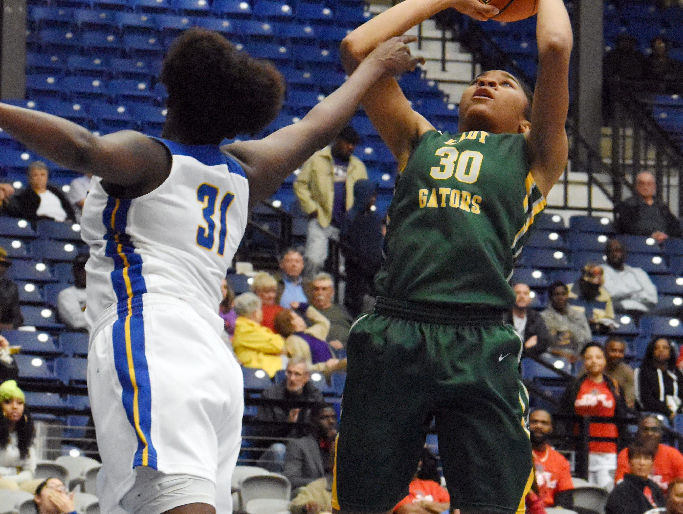 Captain Shreve's Kiayra Ellis (30, right) goes for two against East Ascension in the Class 5A semifinal game of the 2019 Allstate Sugar Bowl 2019 Louisiana High School Athletic Association Girl's State Basketball Marsh Madness held Thursday, Feb. 28, 2019 at the Rapides Parish Coliseum in Alexandria.