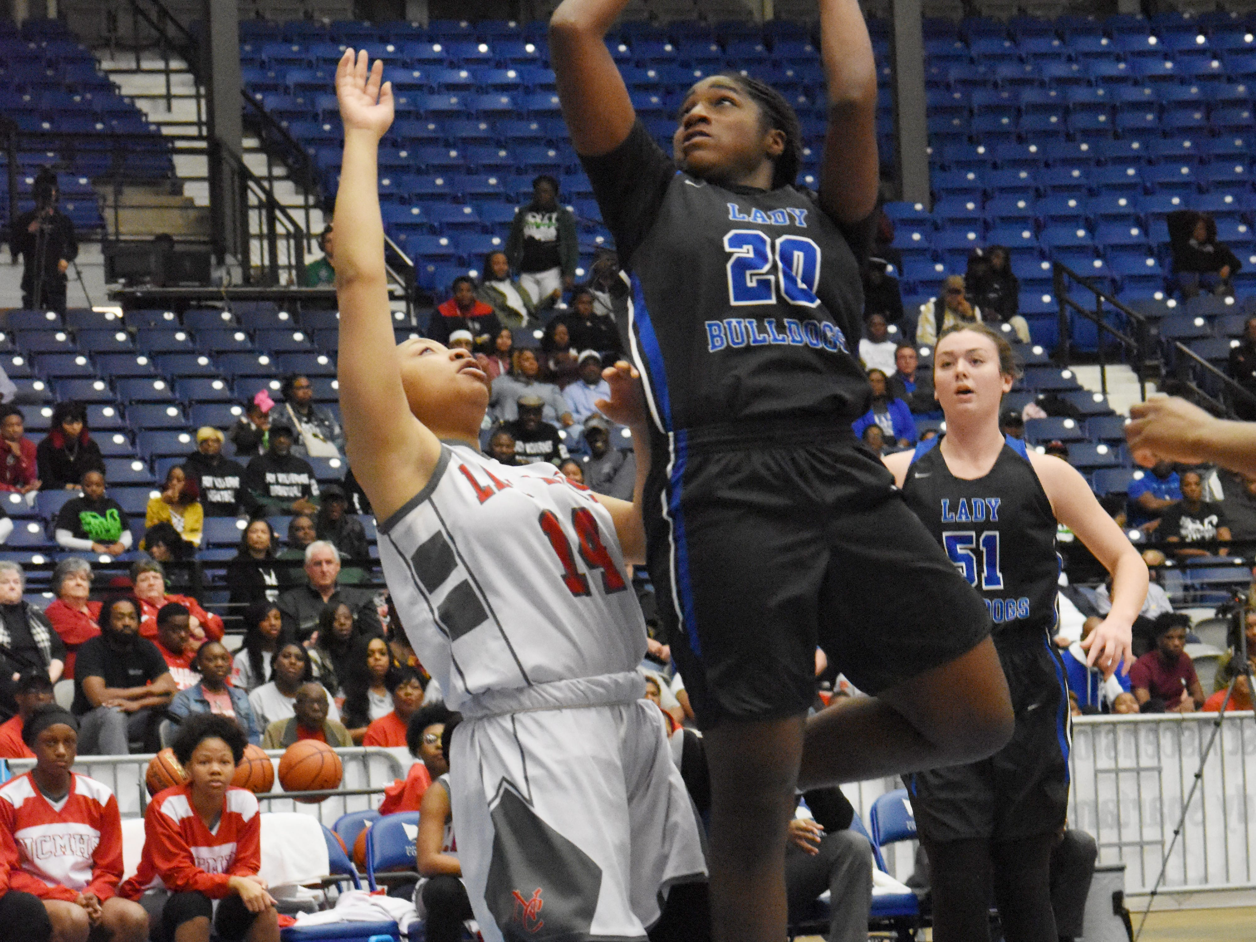Red River's Ma'Kaila Lewis (20, right) goes for two against North Caddo's TaShala Vinson (14, left)  in the Class 2A semifinal game of the 2019 Allstate Sugar Bowl 2019 Louisiana High School Athletic Association Girl's State Basketball Marsh Madness held Thursday, Feb. 28, 2019 at the Rapides Parish Coliseum in Alexandria.