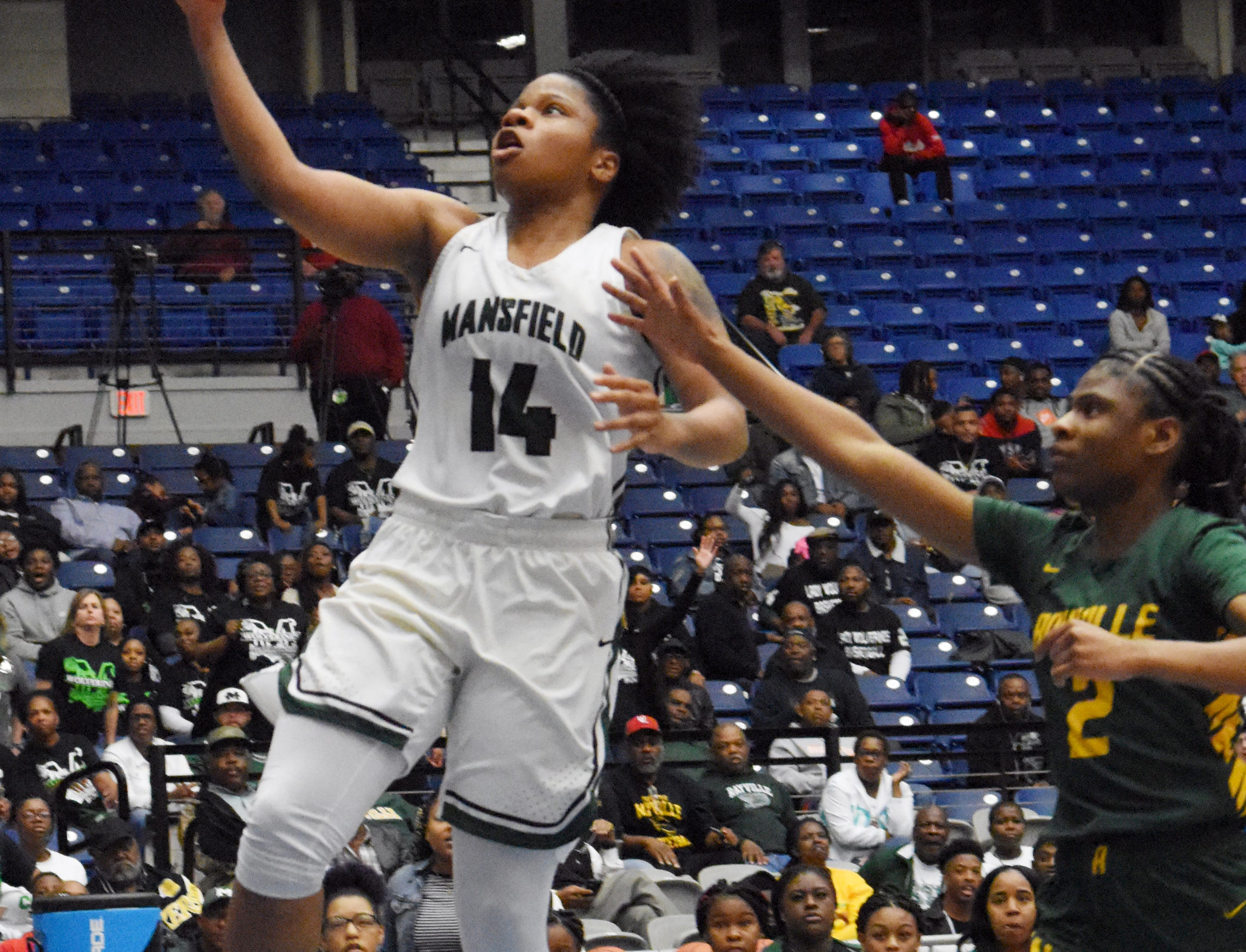 Mansfield's Sha'Korryah Wyatt (14, left) goes up for two against Rayville's Edberly Minnieweather in the Class 2A semifinal game of the 2019 Allstate Sugar Bowl 2019 Louisiana High School Athletic Association Girl's State Basketball Marsh Madness held Thursday, Feb. 28, 2019 at the Rapides Parish Coliseum in Alexandria. Mansfield won 57-49.