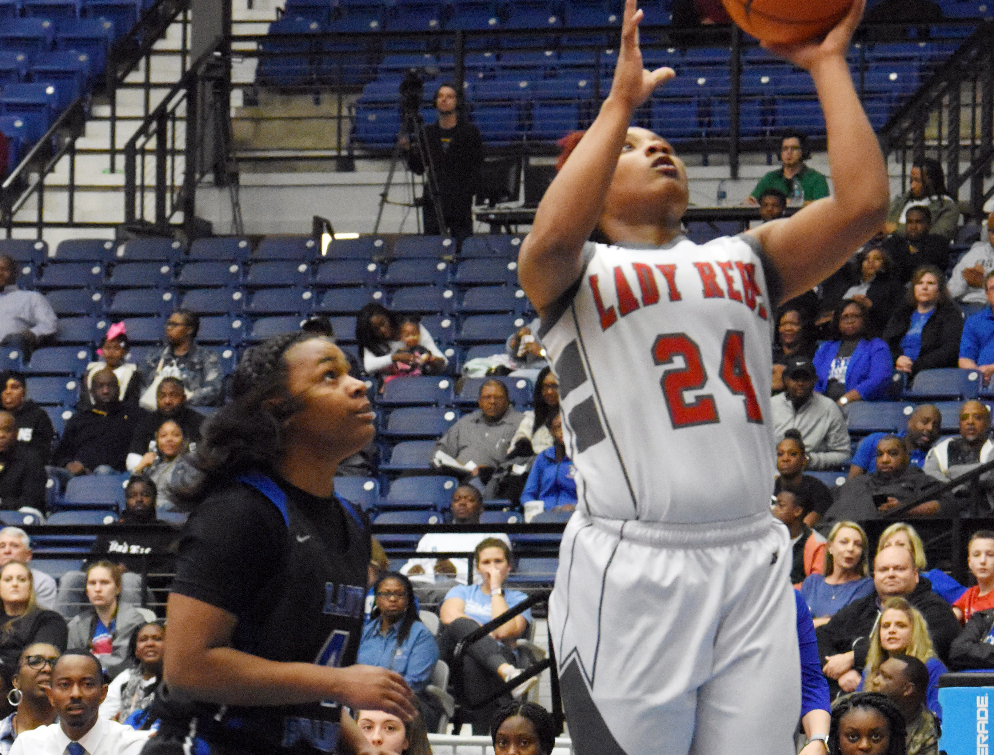 North Caddo's Destiny Rice (24, right) goes for two against Red River's Morgyn Payne (4, left) in the Class 2A semifinal game of the 2019 Allstate Sugar Bowl 2019 Louisiana High School Athletic Association Girl's State Basketball Marsh Madness held Thursday, Feb. 28, 2019 at the Rapides Parish Coliseum in Alexandria.