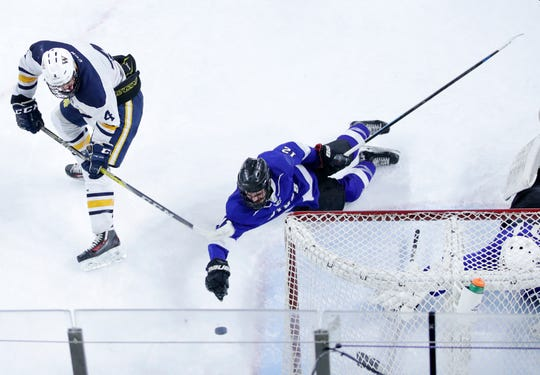 Wausau West's Marc Sippel flicks a shot back to the goal that gets past Waukesha North Co-op's Trenton Tucker before goalkeeper Garrett Larsen stops it at the line with his stick during the WIAA State Hockey Tournament quarterfinals Thursday at Veterans Memorial Coliseum in Madison.