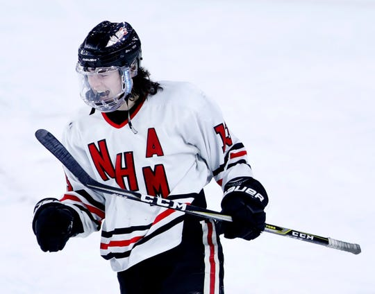 Neenah/Hortonville/Menasha's Luke Elkin celebrates after scoring on an empty net to finish a WIAA state hockey tournament quarterfinal win against Hudson on Thursday in Madison.