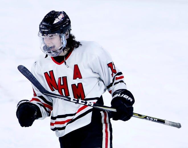 Neenah/Hortonville/Menasha's Luke Elkin celebrates after scoring on an empty net to finish a WIAA state hockey tournament quarterfinal win against Hudson on Thursday in Madison.