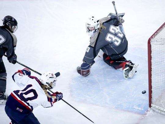 Fox Cities Stars' Maddy Jablonski scores on Cap City Cougars goalie Jenna Jager during the WIAA state hockey semifinals Friday at the Alliant Energy Center in Madison.